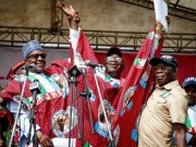 L-R: President Muhammadu Buhari, Dr Kayode Fayemi and Comrade Adams Oshiomhole...at the rally...