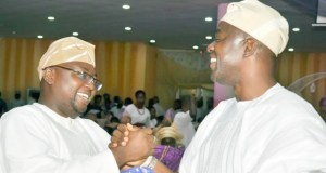 APC's Adebayo Adelabu, left, with Engineer Seyi Makinde of PDP...at the event...