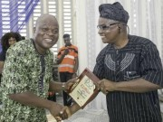 Mr Olayinka Agboola, right, receiving his award at the event...