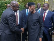 VP Yemi Osinbajo, SAN, with Professor Wale Adebanwi, Director of the African Studies Centre, left…Laolu Akande looks on from the right…