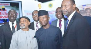 L-R: Chairman, Nigeria Economic Summit Group, Mr. Asue Ighodalo; Minister of Labour and Employment, Dr. Chris Ngige; Managing Director, Shell Nigeria Gas, Mr. Ed Ubong; Vice President, Prof. Yemi Osinbajo; Managing Director, Shell Nigerian Exploration and Production Company, Mr. Bayo Ojulari; and Minister of Budget and National Planning, Senator Udo Udoma, during an inspection of the exhibition booth of Shell Companies in Nigeria…