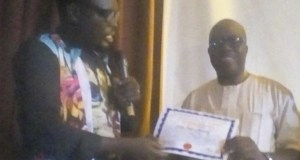The National General Secretary of PMAN, Boniface Itodo (Aitabonny), left, presenting the Certificate of Return to the new governor, Evangelist Taiwo Omotunde after winning the election…