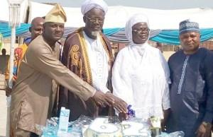 The representative of the Olubadan of Ibadan land, Adeola Oloko, Prof. Olagoke Ariyo and his wife, Alhaj Simiat and Alhaji Lateef Sulaiman during the cutting of the birthday cake…