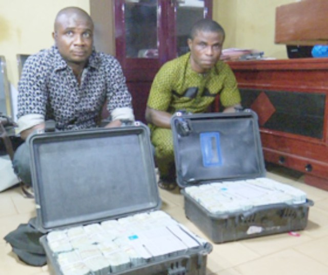 ...the suspected launderers...Ighoh Augustine and Ezekwe Emmanuel...