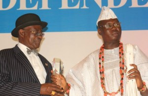 Iba Gani Adams, right, receiving his award...