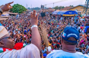 Governor Abiola Ajimobi, right, with APC's gubernatorial candidate, Adebayo Adelabu at the campaign rally...