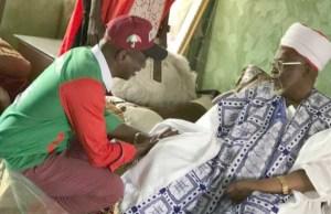 Razak Atunwa, left, with Alh Haliru Kawu Sa'a du, the Emir of Lafiagi...