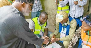 Ondo's Governor Oluwarotimi Akeredolu getting ready to vote on Saturday...