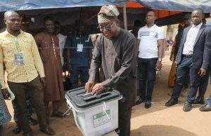 Governor of Osun State, Mr Gboyega Oyetola...casting his vote...