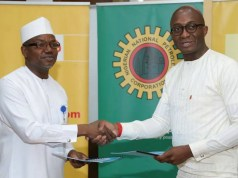 Director and General Manager, Business and Government Relations of The Shell Petroleum Development Company of Nigeria Limited, Bashir Bello (left) exchanging a signed $200 million Shell Contractor Support Fund Memorandum of Understanding with the General Manager Energy Bank of the United Bank for Africa, Ebele Ogbue in Abuja…