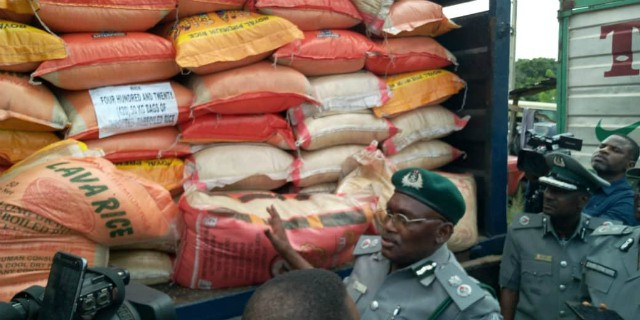 Nigerian Custom Service officers...with some of the seized goods...