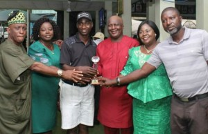 Captain IGC Col. Ade Sumonun (third from right), the overall winner Adetiminrin Adekunle, the lady Captain Sade Oni (third from right) during the prize presentation at 'captain's kitty' of the Ibadan Golf Club…