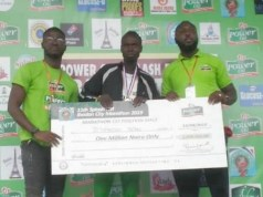 ...Istifanus Peter...the male winner, middle, proudly displays his cheque...