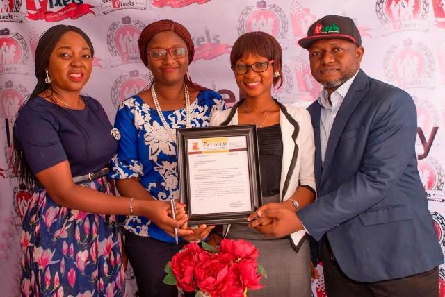 L-R: CEO, Pixels Photography, Omolaraeni Olaosebikan, Deborah-Adebola Moody, Head of Operation, Oluwadolapo Isola, Managing Director and Head of Marketing, Ikechukwu Osuya displaying the certificate of operation from BOTAVED…