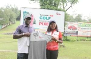 CEO of Pixels Digital Photography, Omolaraeni Olaosebikan (right) presenting golf apparels to Pro-Golfer Saheed Badmus at Ibadan Golf Club…recently…