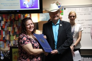 Representative Doc Anderson congratulated Susan Jones with a surprise classroom visit and House of Representatives Resolution.