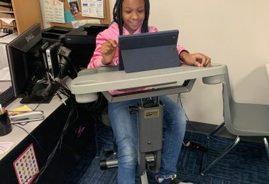 Student learning on the exercise bike