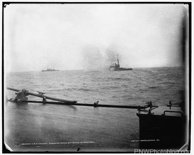 The Oregon firing at the fortifications outside of Santiago Bay