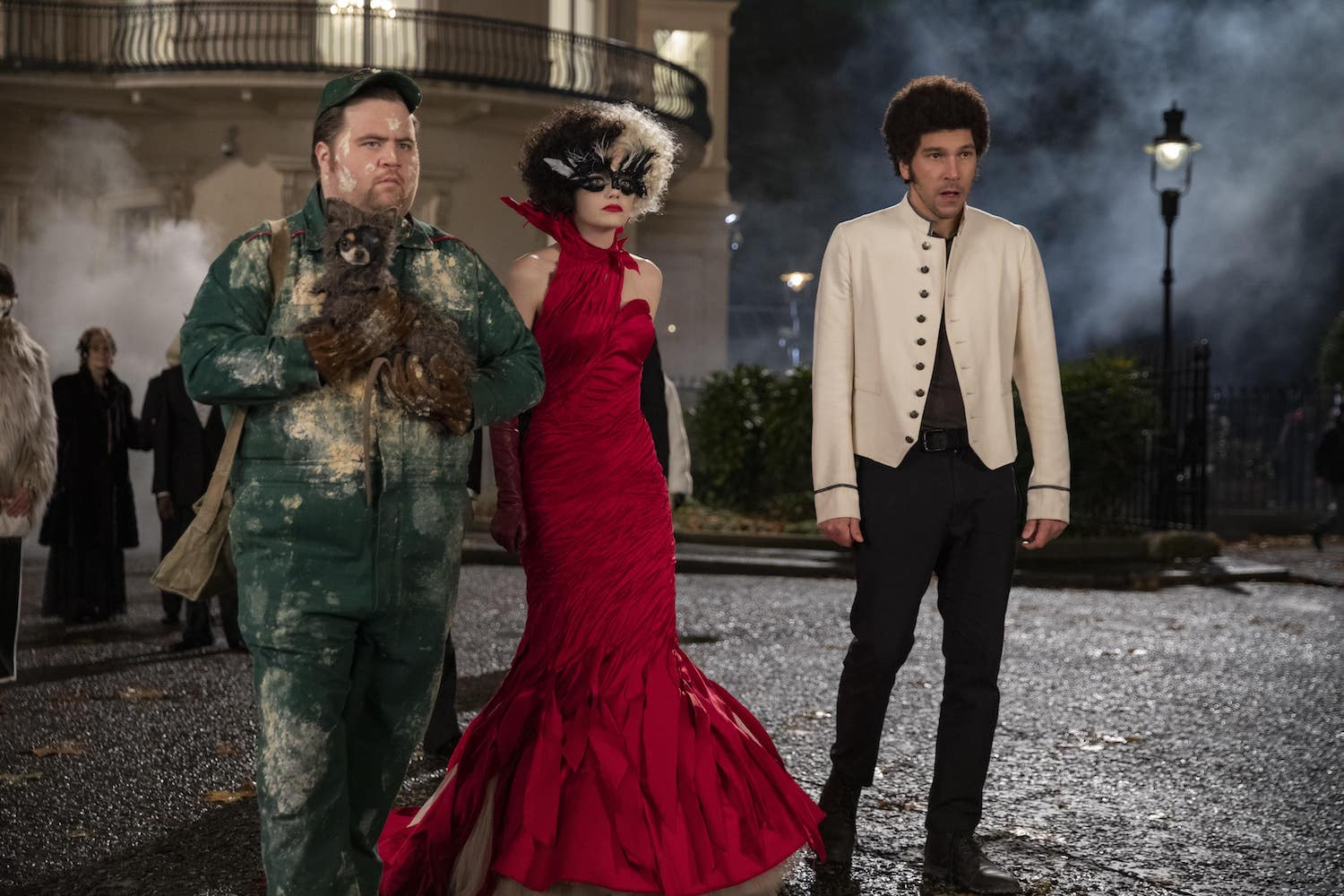 (L-R): Paul Walter Hauser as Horace, Emma Stone as Cruella and Joel Fry as Jasper in Disney's live-action CRUELLA. Photo by Laurie Sparham. © 2021 Disney Enterprises Inc. All Rights Reserved.