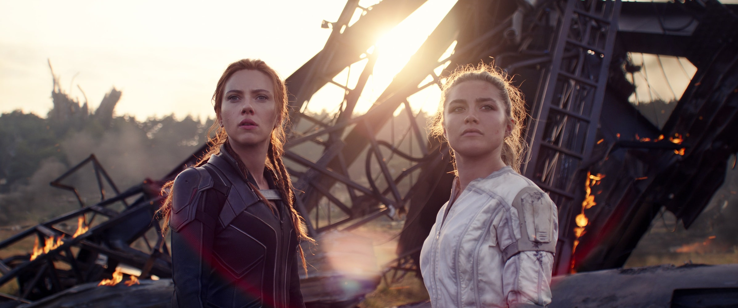 (L-R): Black Widow/Natasha Romanoff (Scarlett Johansson) and Yelena (Florence Pugh) in©Marvel Studios' BLACK WIDOW, in theaters and on Disney+ with Premier Access. Photo courtesy of ©Marvel Studios. ©Marvel Studios 2021. All Rights Reserved.