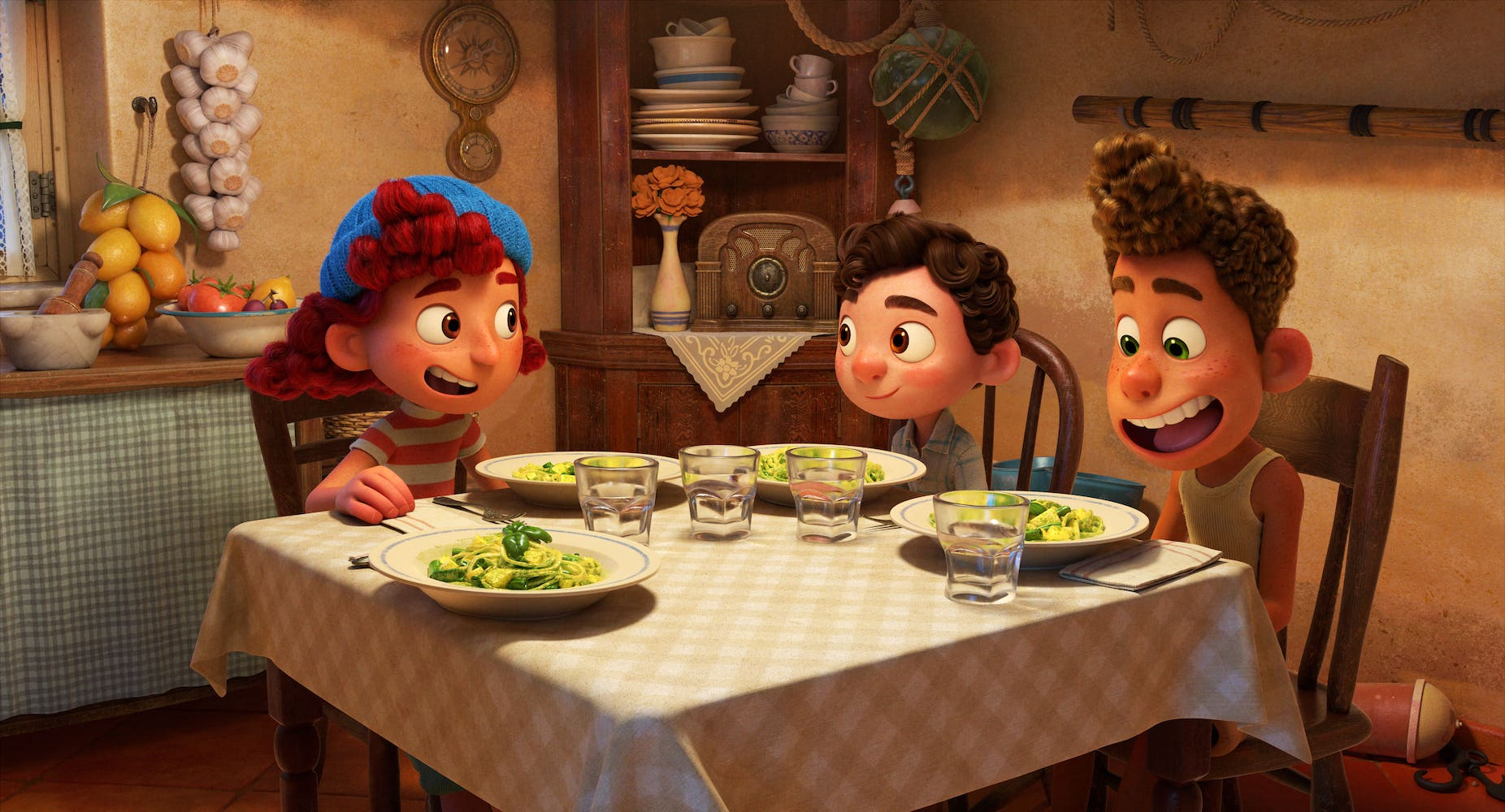 """TRENETTE AL PESTO! -- Emma Berman, Jacob Tremblay and Jack Dylan Grazer provide the voices of a trio of new friends in Disney and Pixar's """"Luca."""" Outgoing and charming, Giulia invites Luca and Alberto to her house where they have pasta for the first time—it's a hit. What she doesn't know, however, is that her new friends are actually sea monsters who just look human when they're dry. Directed by Academy Award® nominee Enrico Casarosa (""""La Luna"""") and produced by Andrea Warren (""""Lava,"""" """"Cars 3""""), """"Luca"""" debuts on Disney+ on June 18, 2021. © 2021 Disney/Pixar. All Rights Reserved."""