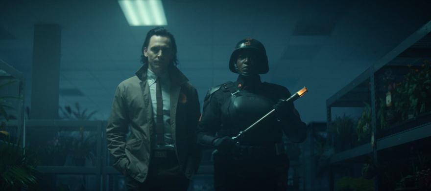 (L-R): Loki (Tom Hiddleston) and Hunter B-15 (Wunmi Mosaku) in Marvel Studios' LOKI, exclusively on Disney+. Photo courtesy of Marvel Studios. ©Marvel Studios 2021. All Rights Reserved.