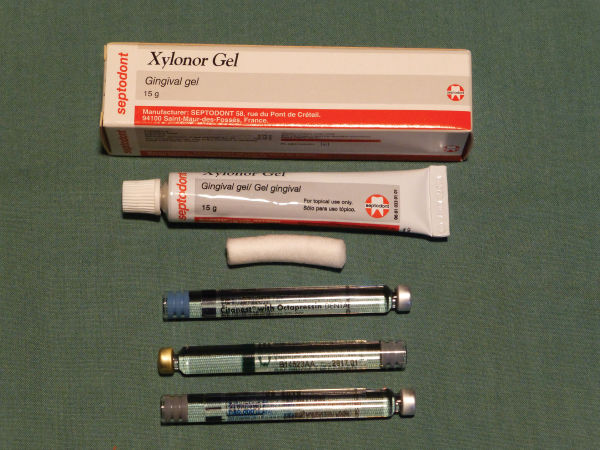 Photo showing Topical anaesthetic gel and anaesthetic cartridges.