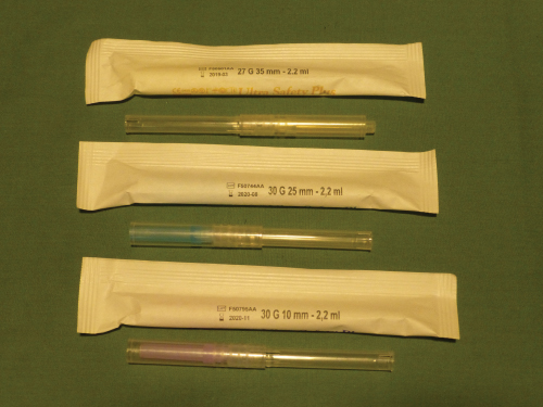 Photo showing Ultra-safety-plus disposable sterile syringe.