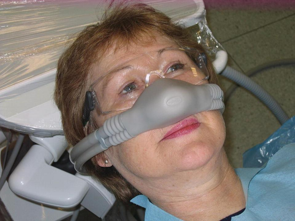 A woman wearing a porter nasal scavenging mask.