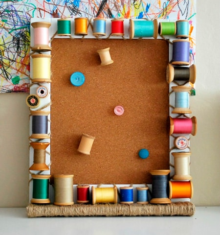 Functional frame decorated with spools of thread