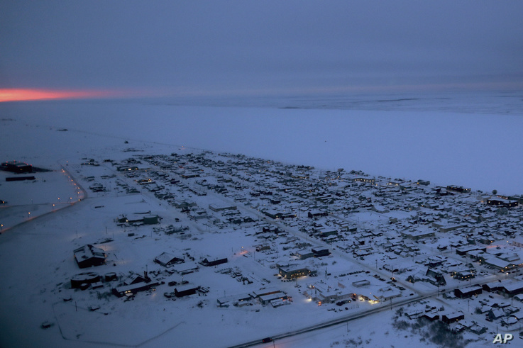 In this Feb. 15, 2019, photo, the sun rises in the horizon at the start of the day in Nome, Alaska. (AP Photo/Wong Maye-E)