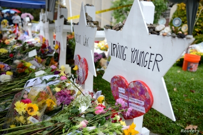 FILE - Flowers and other items have been left as memorials outside the Tree of Life synagogue following last Saturday's shooting in Pittsburgh, Pennsylvania, Nov. 3, 2018.