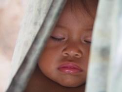 Waorani infant, Ecuador