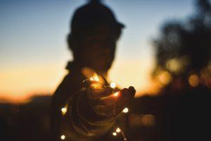 man holding light