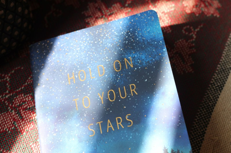 blue notebook reading 'hold onto your stars', symbolizing a thoughtful possibility for what to do and where to go in buying secondhand