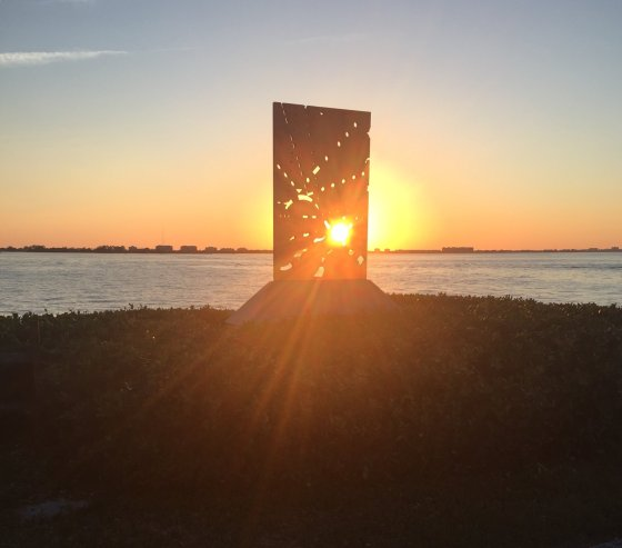 Sunset through a sculpture