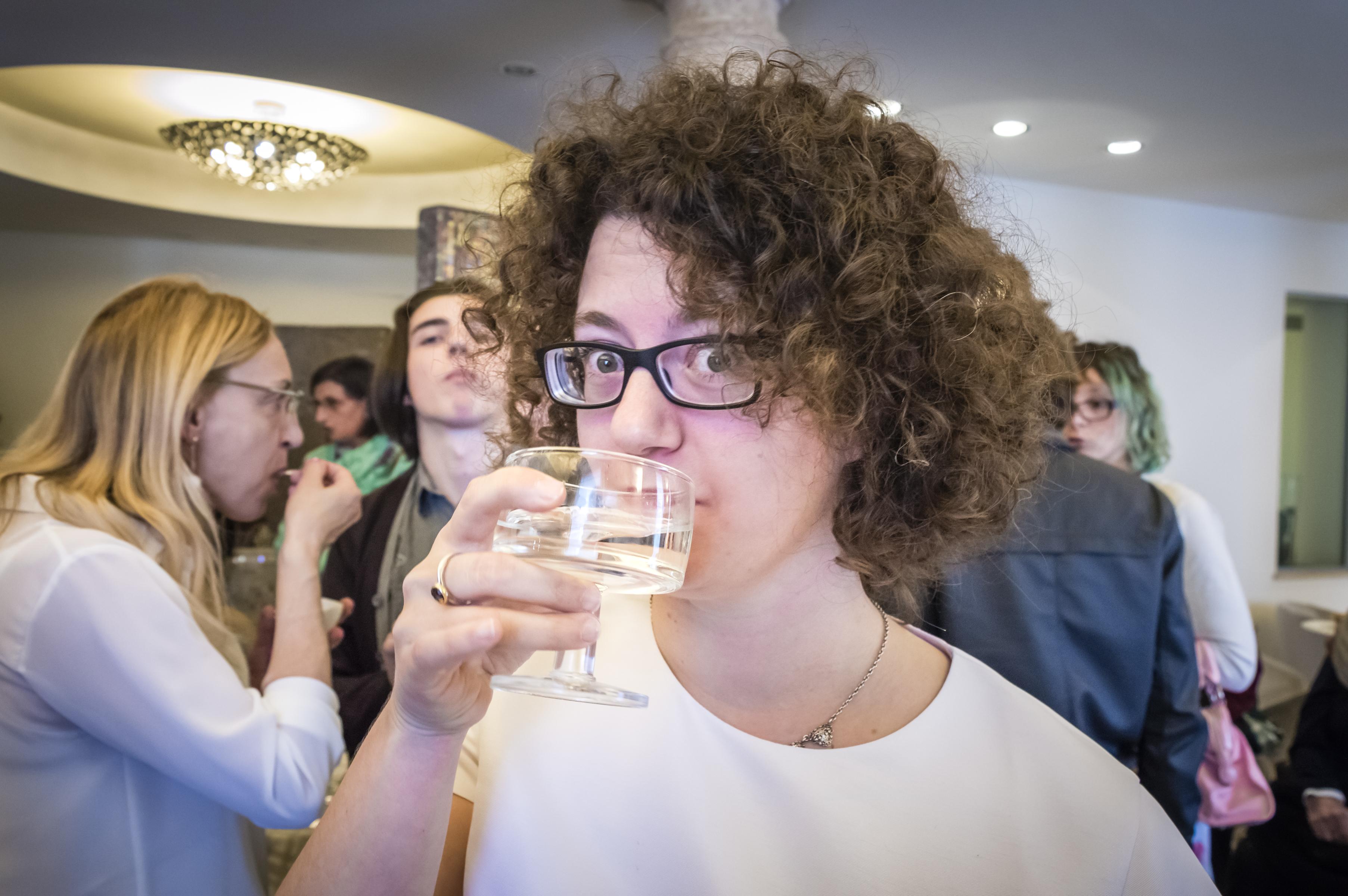 greta drinking prosecco