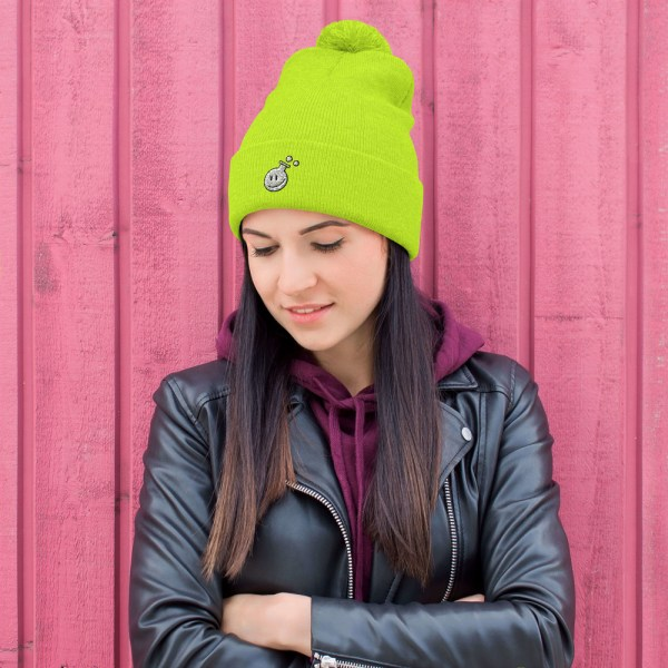 photo of a girl wearing a yellow hat for winter with a cozy pompom