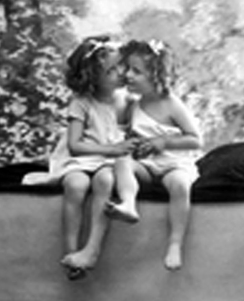 Stock Photo of Two Little Girls, Sisters Or Friends, Sitting On