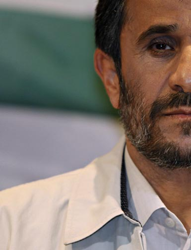 ahmadinejad looks on