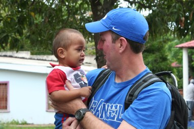 Braxton Brady holds a boy who has been abandoned by his family at the INFHA orphanage.