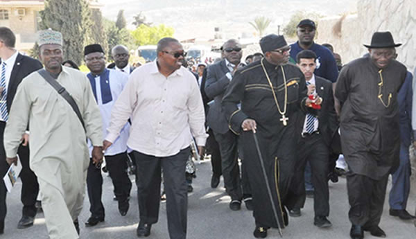 FROM LEFT: MINISTER OF INFORMATION/SUPERVISING MINISTER OF DEFENCE, MR LABARAN MAKU; GOV PETER OBI OF ANAMBRA; PRESIDENT, CHRISTIAN ASSOCIATION OF NIGERIA, PASTOR AYO ORITSEJAFOR AND PRESIDENT GOODLUCK JONATHAN WALKING DOWN THE PALM SUNDAY ROAD TO THE CHAPEL OF DOMINOUS FLEVIT