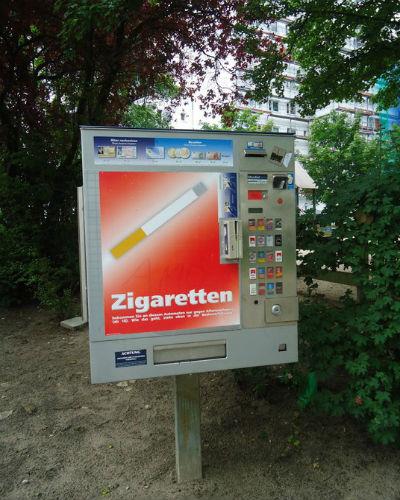 Cigarette vending machine by the neighborhood playground