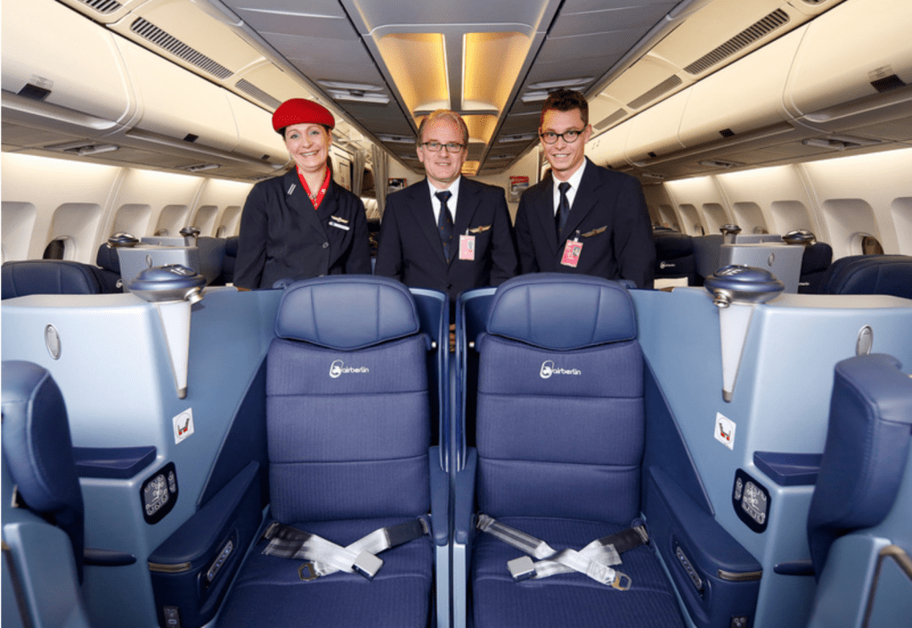 Air Berlin flight attendants show off the airline's new lie-flat business class seats.
