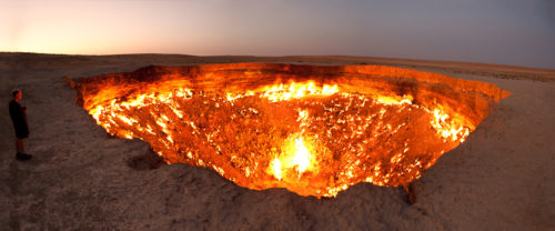 The Door to Hell, a burning natural gas field in Derweze, Turkmenistan. Photo by Tomrod Sandtorv and Hellbus. Used with permission.