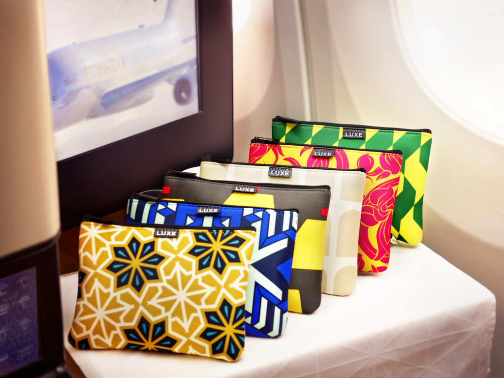 The new lineup of Etihad Airways amenity kits for Business Class passengers.