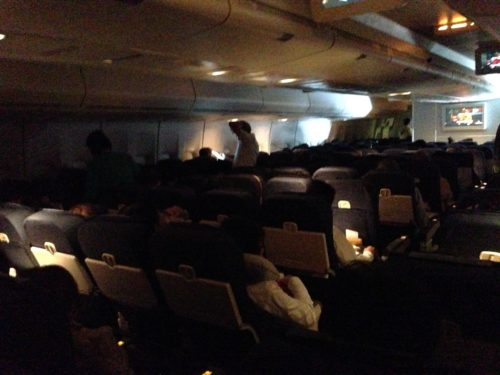 A (terrible) photo of United Airlines' in-flight entertainment onboard the 747, featuring mainscreen programming.