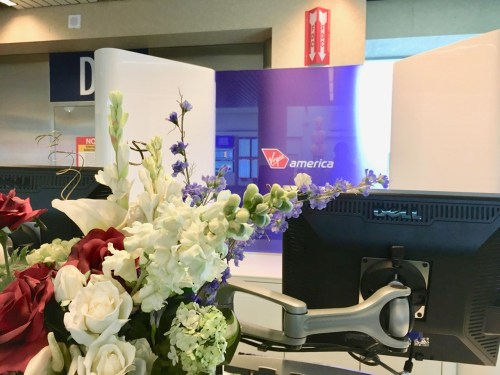 Flowers on the pedestal at Virgin America's Portland International Airport (PDX) gate.