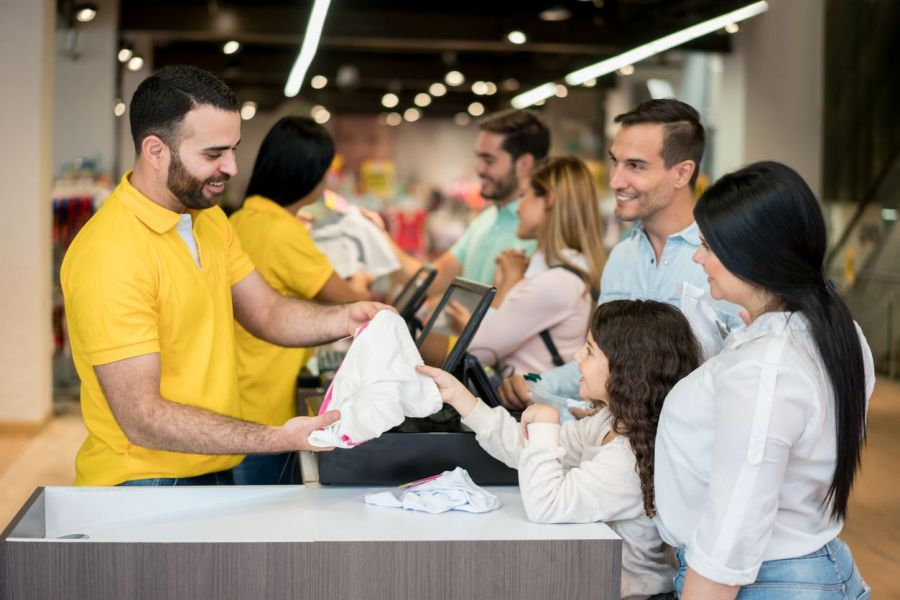 PointofSale retail clerk helping customers Retail customer service tips