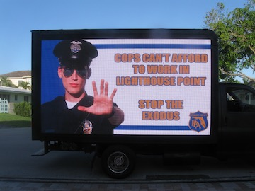In April a truck drove around Lighthouse Point with billboards to spread awareness about the pension problems in Lighthouse Point.